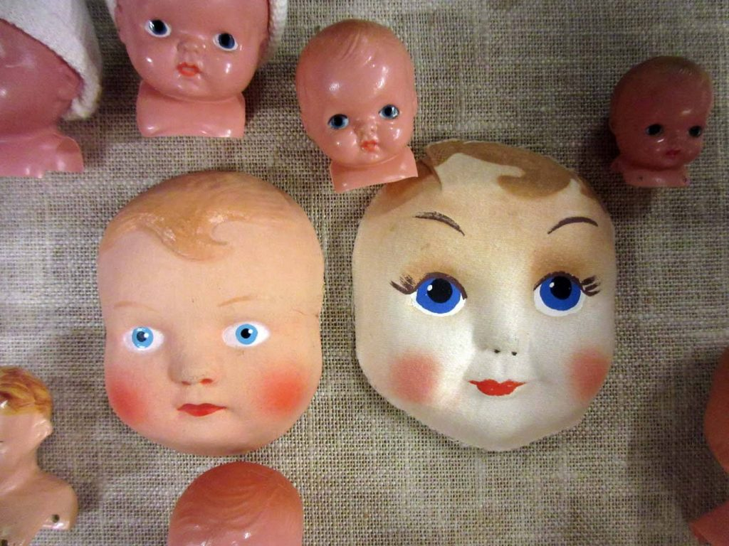 Doll faces in Stockholm toy museum